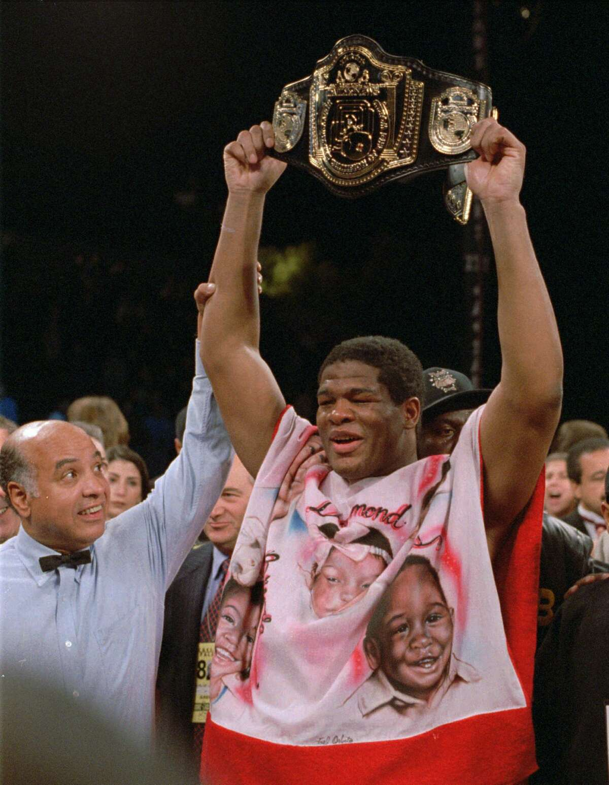 """FILE -- In this Nov. 4, 1994, file photo, referee Joe Cortez, left, signals heavyweight champion Riddick Bowe the winner as Bowe celebrates his victory over Evander Holyfield at Caesars Palace in Las Vegas. Riddick Bowe, who beat undisputed champion Evander Holyfield to win the heavyweight boxing title in 1992, and popular lightweight champion Ray """"Boom Boom"""" Mancini have been selected for induction into the International Boxing Hall of Fame. The induction ceremony will be held June 14 at the Hall of Fame in upstate New York. (AP Photo/Lennox McLendon, File) ORG XMIT: NY172"""