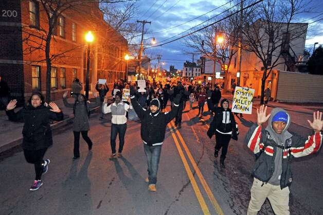 Protestors march down the middle of Henry Johnson Boulevard during a march and rally to protest NYC grand jury decision on Wednesday, 12/3, not to indict police offers involved in choke-hold death of Eric Garner,in addition to the Ferguson, Mo. Michael Brown case on Thursday Dec. 4, 2014 in Albany, N.Y.  (Michael P. Farrell/Times Union) Photo: Michael P. Farrell / 00029747A