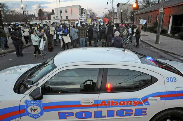 An Albany Police cruiser blocks Henry Johnson Boulevard  from traffic as protestors gather in front of Police headquarters during a march and rally to protest NYC grand jury decision on Wednesday, 12/3, not to indict police offers involved in choke-hold death of Eric Garner,in addition to the Ferguson, Mo. Michael Brown case on Thursday Dec. 4, 2014 in Albany, N.Y.  (Michael P. Farrell/Times Union) Photo: Michael P. Farrell / 00029747A