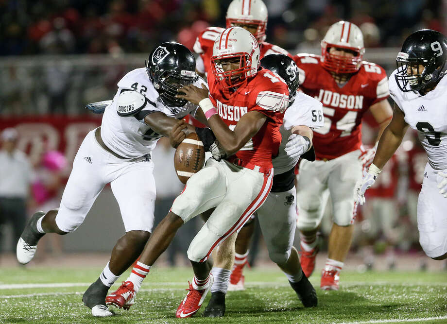 Judson's Isaiah Gibson (center) loses the ball as he is hit by Steele's Mark Jackson (left) and Chris Boring (behind) during the second half of their game at Rutledge Stadium on Friday, Oct. 24, 2014. Steele scored the go-ahead touchdown with 16 seconds remaining in the game to beat the Rockets 23-22. Photo: Marvin Pfeiffer /San Antonio Express-News / Express-News 2014