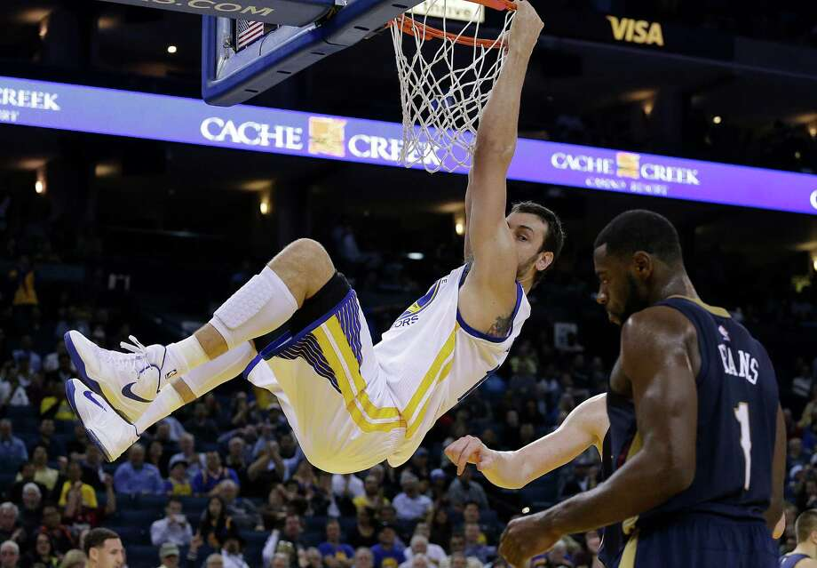 The Warriors will need to have Andrew Bogut hanging in next spring more than they do now. His right knee is problematic. Photo: Ben Margot / Associated Press / AP