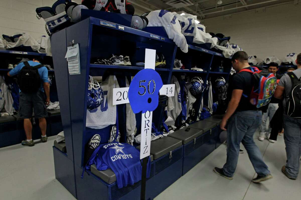 A memorial is shown Wednesday, Dec. 3, 2014 at the locker of Edna football player Noah Ortiz, 15, who was killed along with four of his siblings in a mobile home fire on Nov. 25. ( Melissa Phillip / Houston Chronicle )