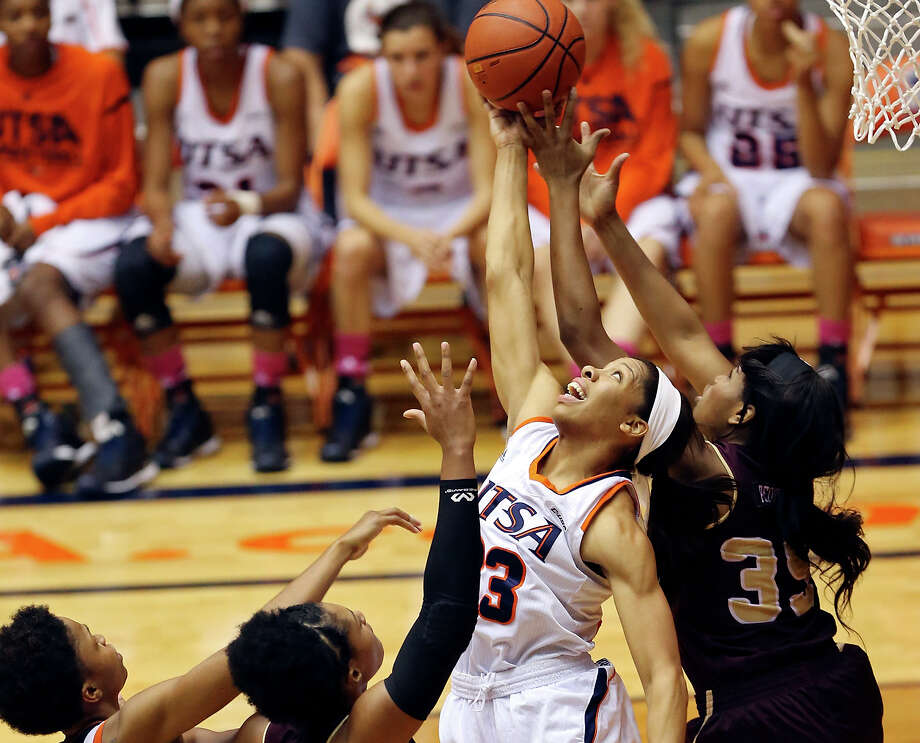 UTSA' s Tesha Smith (from left), Texas State's Kileah Mays, UTSA's Mannasha Bell and Texas State's Erin Peoples grab for a rebound during second half action Thursday Dec. 4, 2014 at the UTSA Convocation Center. Texas State won 57-53. Photo: Edward A. Ornelas, Staff / San Antonio Express-News / © 2014 San Antonio Express-News
