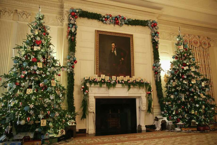Holiday decorations are seen in the State Dining Room of the White House. The first lady hosted military families to the White House to first view this years holiday decorations. Journalists are invited to White House parties, too. But they are better off not going. Photo: Alex Wong /Getty Images / 2014 Getty Images