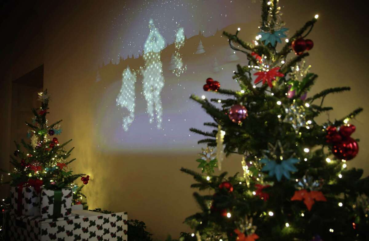 """WASHINGTON, DC - DECEMBER 03: An interactive installation which visualizes visitors in a snowscape projected on the wall with live movement is seen at the East Garden Room of the White House December 3, 2014 in Washington, DC. The first lady hosted military families to the White House to first view this years holiday decorations which the theme is """"A Children's Winter Wonderland."""" (Photo by Alex Wong/Getty Images)"""