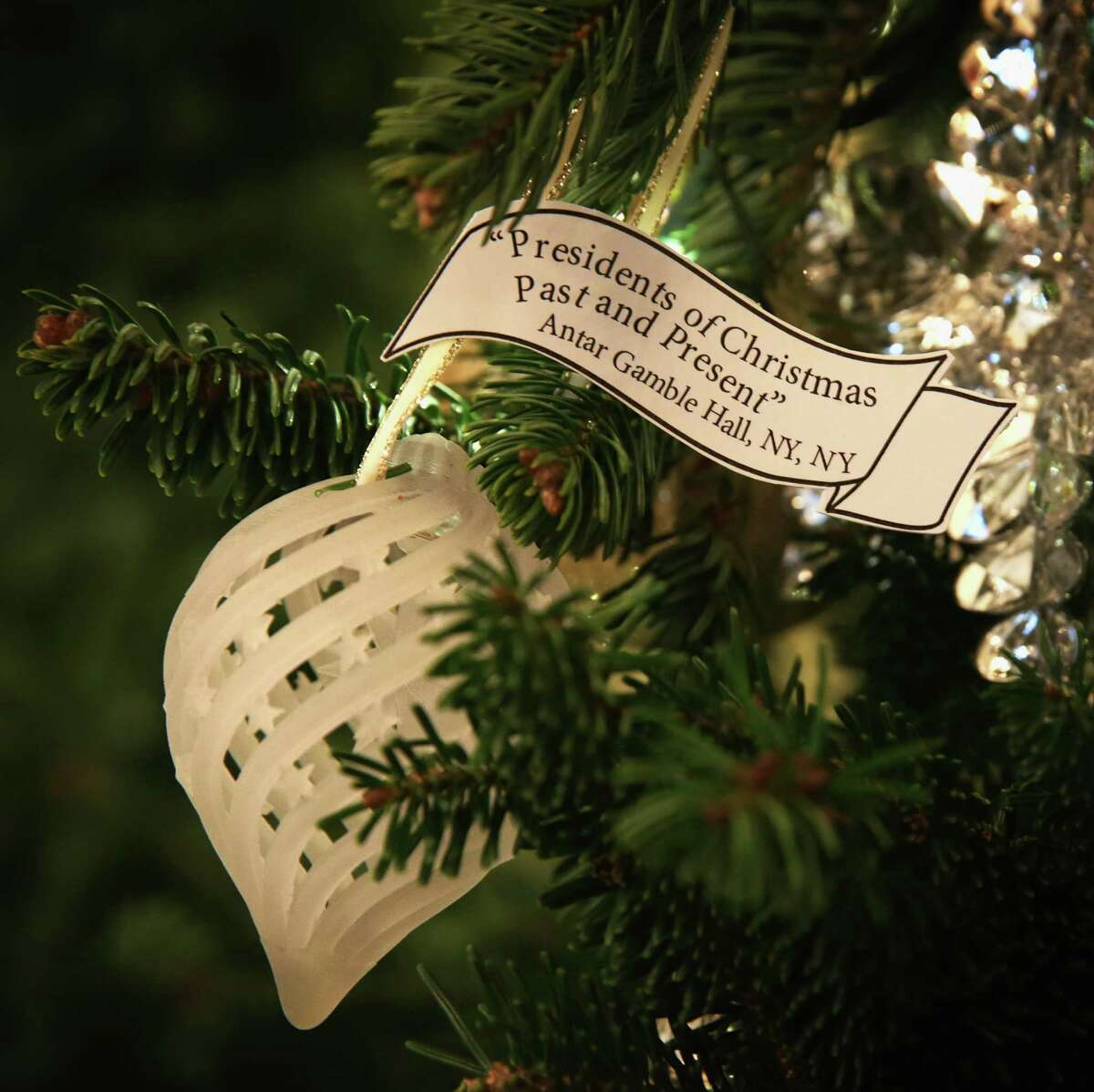"""WASHINGTON, DC - DECEMBER 03: A 3D printed ornament is hung on a Christmas tree in the Red Room of the White House December 3, 2014 in Washington, DC. The first lady hosted military families to the White House to first view this years holiday decorations which the theme is """"A Children's Winter Wonderland."""" (Photo by Alex Wong/Getty Images)"""