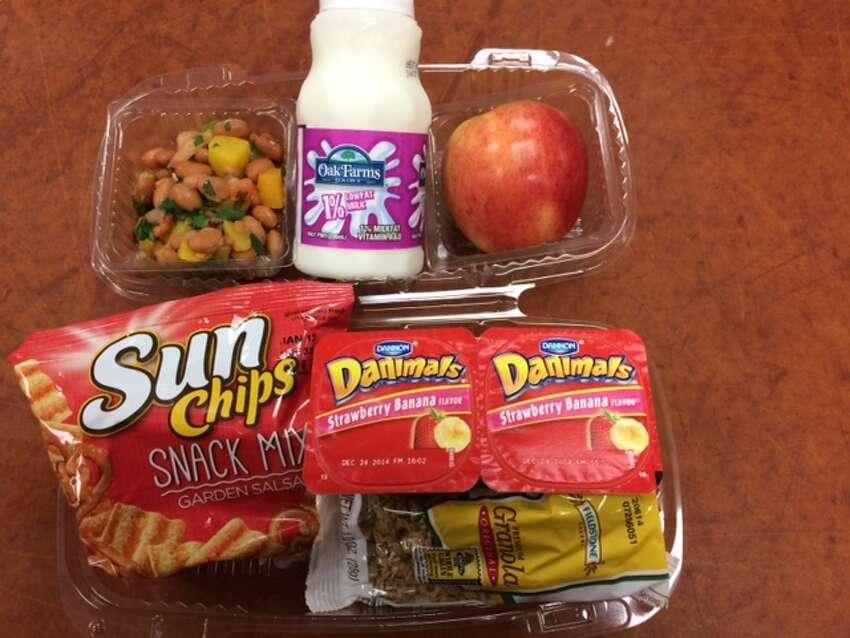 Churchill High School (NEISD) Yogurt, granola, baked chips, apple, pinto bean salad, 1% milk