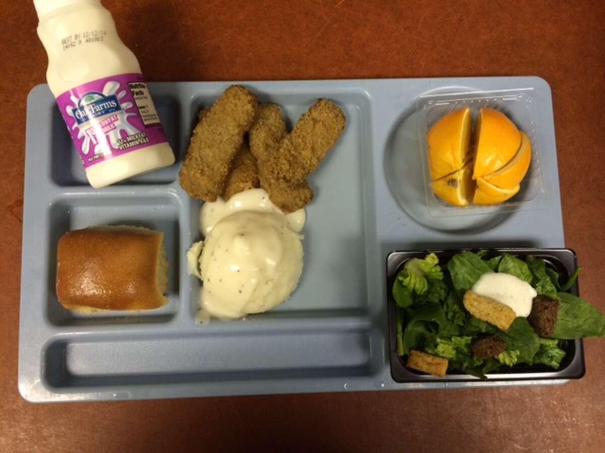 Oak Meadow Elementary (NEISD) Steak fingers, mashed potatoes with gravy, whole grain roll, salad, orange, 1% milk