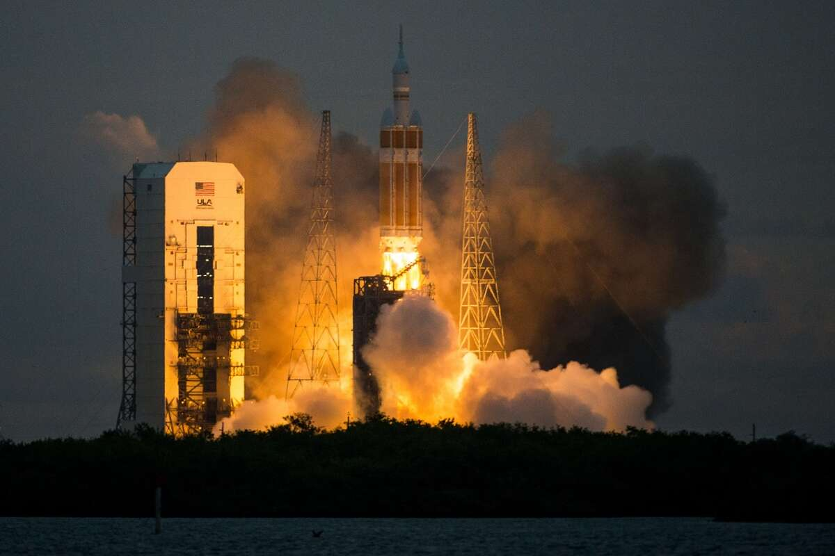 NASA's Orion spacecraft launches atop a United Launch Alliance Delta 4 rocket from Space Launch Complex 37 at the Cape Canaveral Air Force Station for on Friday, Dec. 5, 2014. The unmanned flight, designated Exploration Flight Test-1, will orbit Earth twice and travel to an altitude of 3,600 miles into space before splashing down in the Pacific Ocean approximately 600 southwest of San Diego. ( Smiley N. Pool / Houston Chronicle )