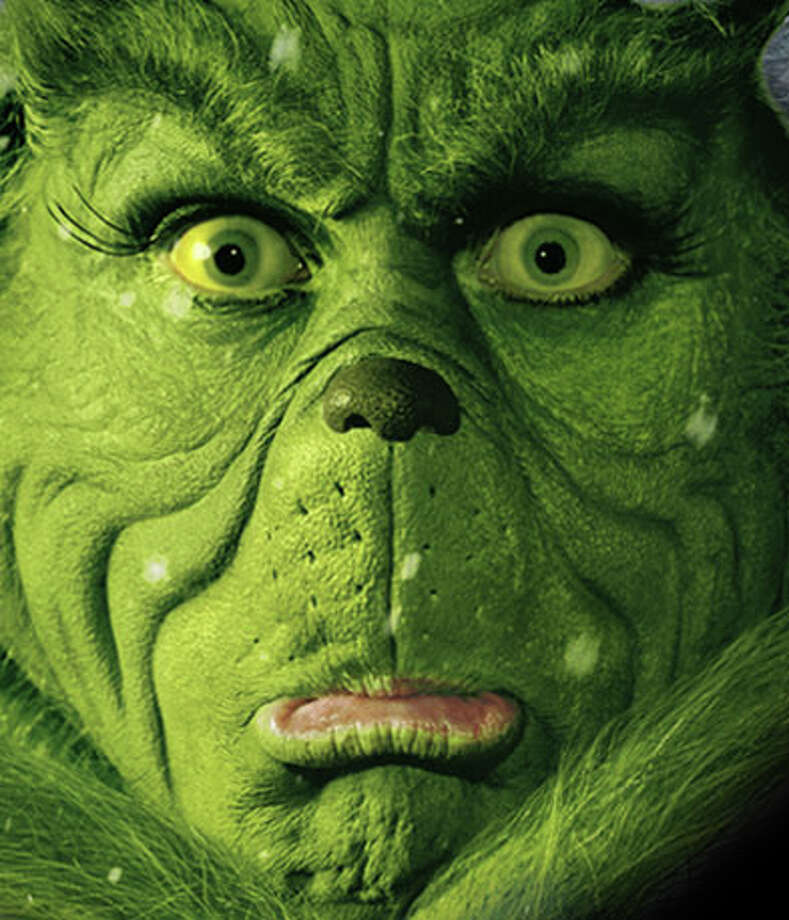 (KN19) KRT KIDNEWS STORY SLUGGED: WORDUP KRT PHOTOGRAPH (November 18)   You're a mean one, Mr. Grinch: Being the Grinch isn't easy. Just ask Jim Carrey. According to Newsweek, Carrey's tranformation into the Green One took three hours in makeup - on a good day. On a bad day, Carrey didn't want to get into costume at all, especially the painful yellow-colored contact lenses. Finally, a fed-up Carrey rebelled, and the contact lenses were ditched for digital special effects that make Carrey's eyes yellow. No wonder that Grinch was so grumpy    (KRT) AP PL KD 2000 (Vert) (lde) (Diversity).     HOUCHRON CAPTION (12/24/2004)  SECSTAR COLOR: MOLDY: GRINCH: A MEAN ONE: Carrey's costume couldn't hide enough of him in the disappointing 2000 remake of Dr. Seuss' ``How the Grinch Stole Christmas.'' Photo: HO / KRT