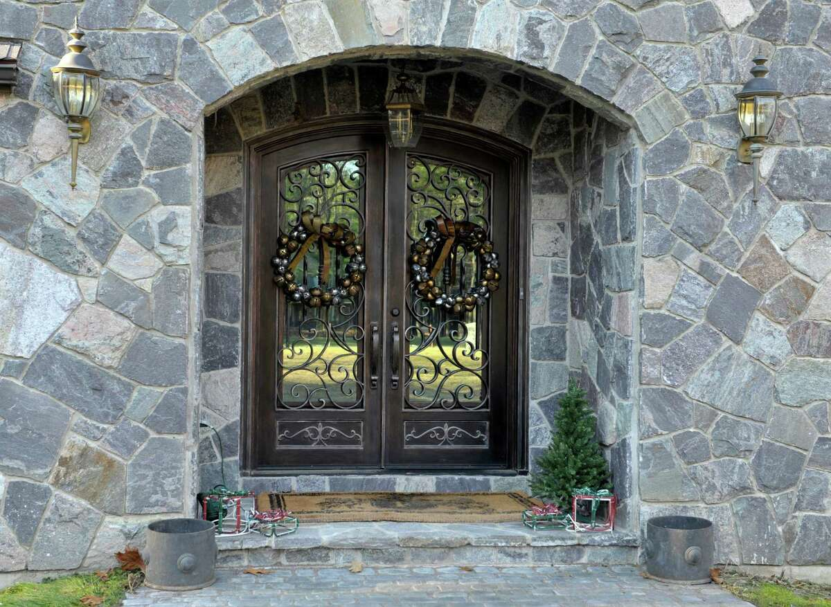 An arched doorway from a soft curve to a steep pitch are typical to Tudors. (Paul Buckowski / Times Union)