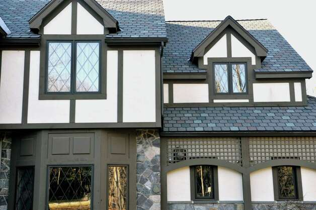 Gables, like these on 5 Oakbrook Blvd. in Saratoga Springs, are often found on Tudors.  (Paul Buckowski / Times Union) Photo: Paul Buckowski / 00029684A