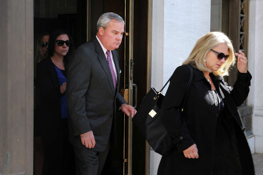 Former Gov. John G. Rowland and his wife Patty, right, leave the Federal Courthouse in New Haven, Conn. Sept. 19, 2014. A jury found Rowland guilty on all seven federal counts of violating campaign laws, including falsifying records, conspiracy, making false statements to the Federal Election Commission and creating illegal campaign contributions. Photo: Ned Gerard / Connecticut Post