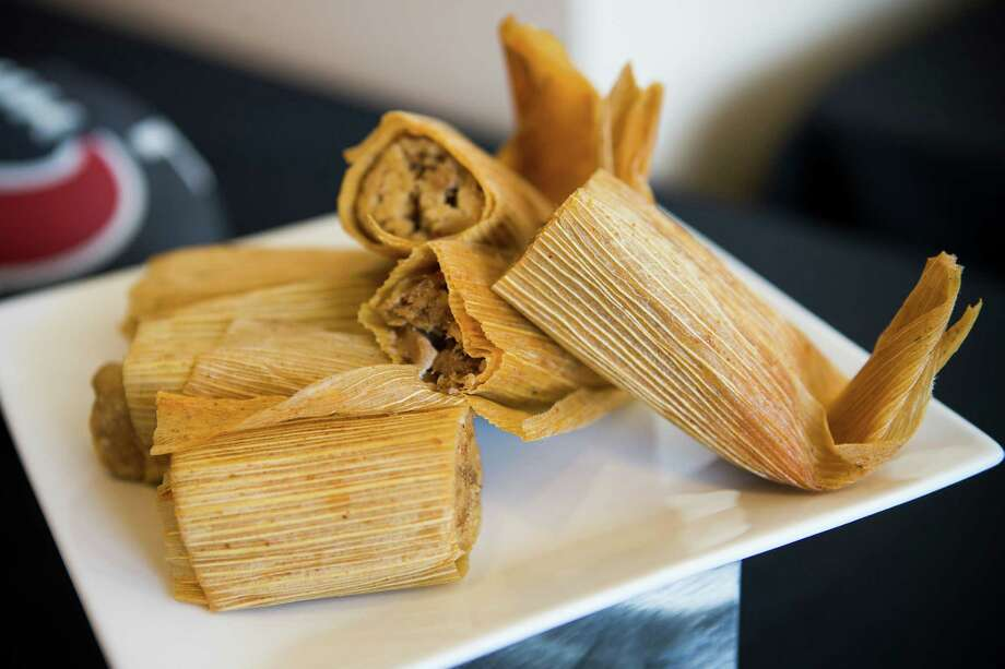 Pork tamales from Berryhill Baja Grill are shown during a preview of food and merchandise offerings at NRG Stadium on Wednesday, Sept. 3, 2014. The original Berryhill's is moving to 2300 Westheimer. Photo: Brett Coomer, Houston Chronicle / © 2014  Houston Chronicle