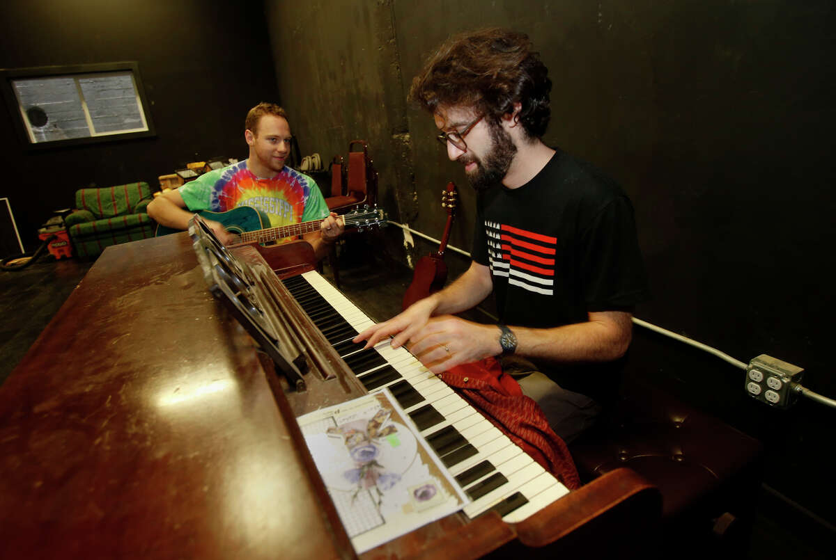 Andy Strong (left) and Arlen Hart rehearse in one of the studio areas at PianoFight, the theater-restaurant complex slated to open soon at the old Original Joe's location.