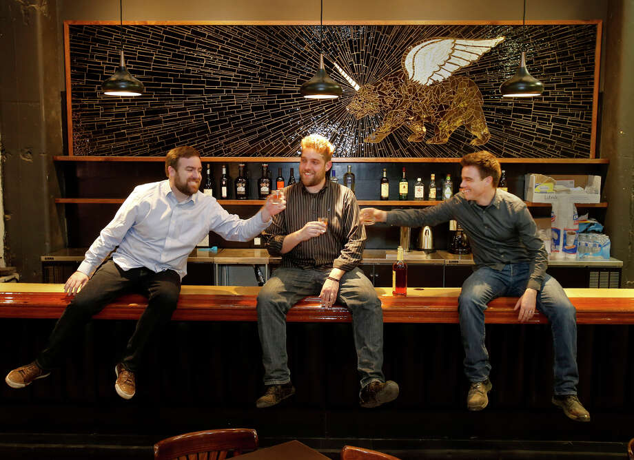 PianoFight co-founders Kevin Fink (left), Rob Ready and Dan Williams enjoy a toast at the bar in their new venture. Photo: Brant Ward / The Chronicle / ONLINE_YES