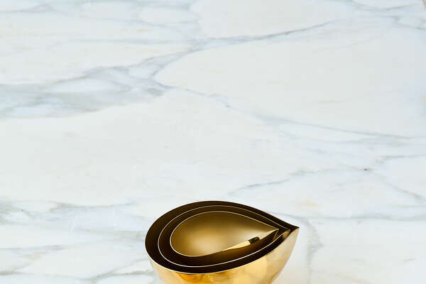 """Shell Company New York designer David Weeks is best known for his sleek lighting, featuring forms that evoke bird crests, horns, and globes. Now he's conquering the table with elegant brass nesting bowls. With a shape borrowed from his classic shell sconce, the bowls have a matte glass-bead interior and a shining polished exterior. A set of three costs $550; the largest measures 7"""" l. ?- 5"""" w. ?- 3"""" h.  212-966-3433;davidweeksstudio.com 21 White Kitchens To Inspire Your Next RemodelA Historical Home with Charm to SpareTour a Home on the Island of CapriThe 10 Things Every Bedroom Needs12 Sweet Spaces for Casual Kitchen Dining A Fashion Executive's Grecian Getaway"""