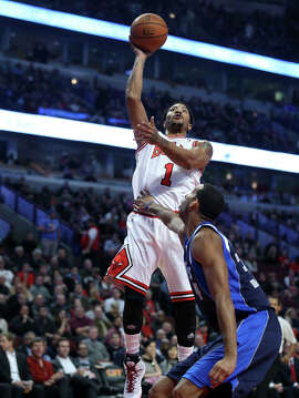 At least Derrick Rose (1) is in the Bulls' lineup after years of being hurt, but he guards his health so much his image suffers.