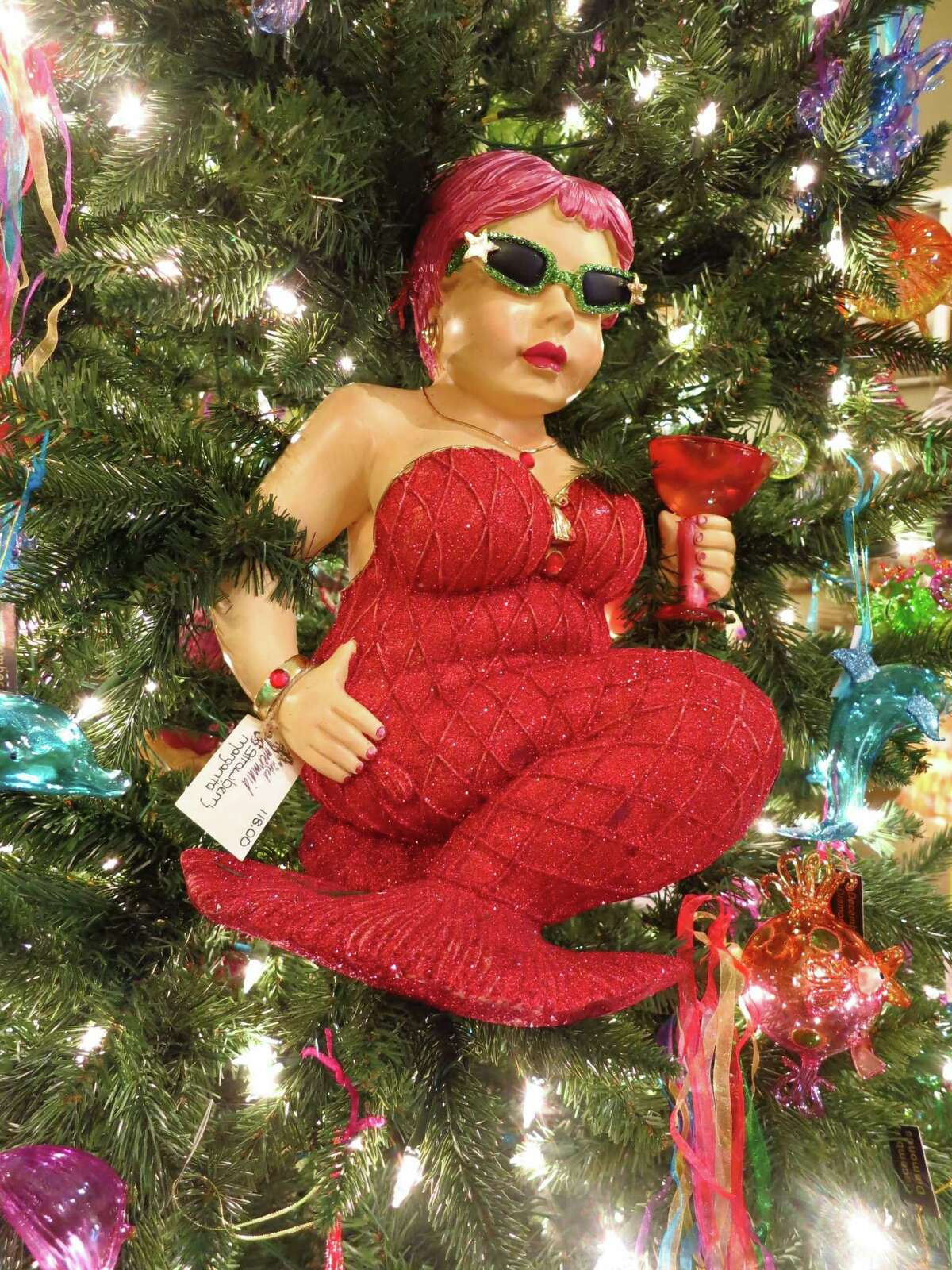 The shop is called The Naked Mermaid, but this mermaid tree ornament comes all decked out in holiday finery in Galveston.
