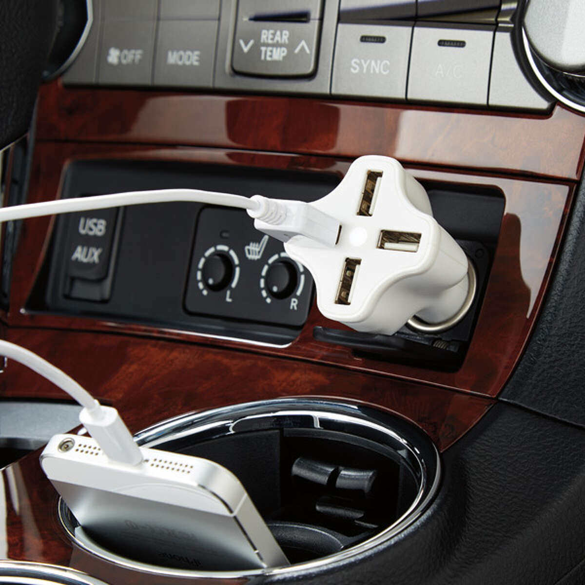 A Four-Port USB car charger from The Container Store makes it easy to keep everyone's cellphones charged during road trips.