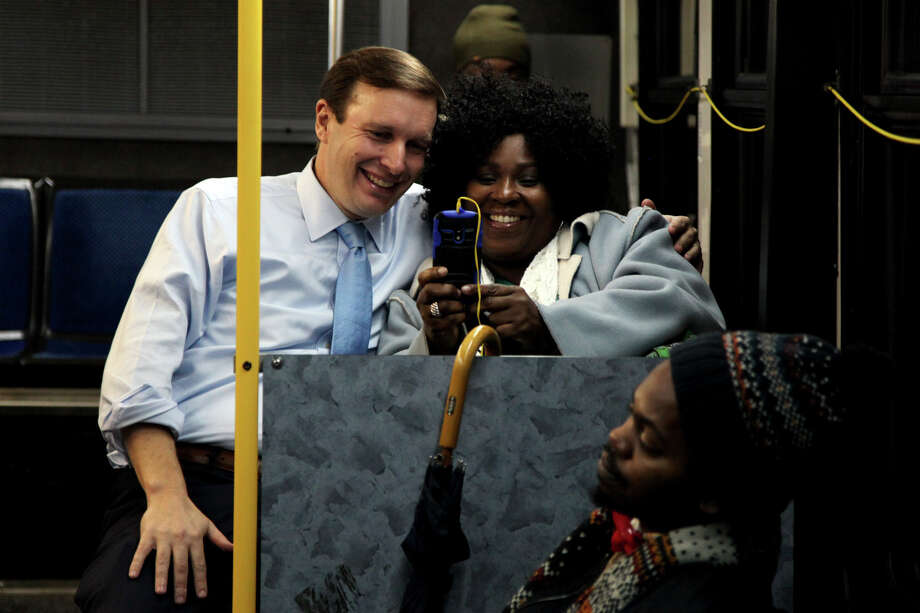 Sen. Chris Murphy, D-Conn., takes a selfie with a woman he met on this CT Transit bus Monday, Nov. 24, 2014, in Hartford, Connecticut. Photo: Connor Radnovich, Connor Radnovich/Hearst Newspape / Connecticut Post Contributed
