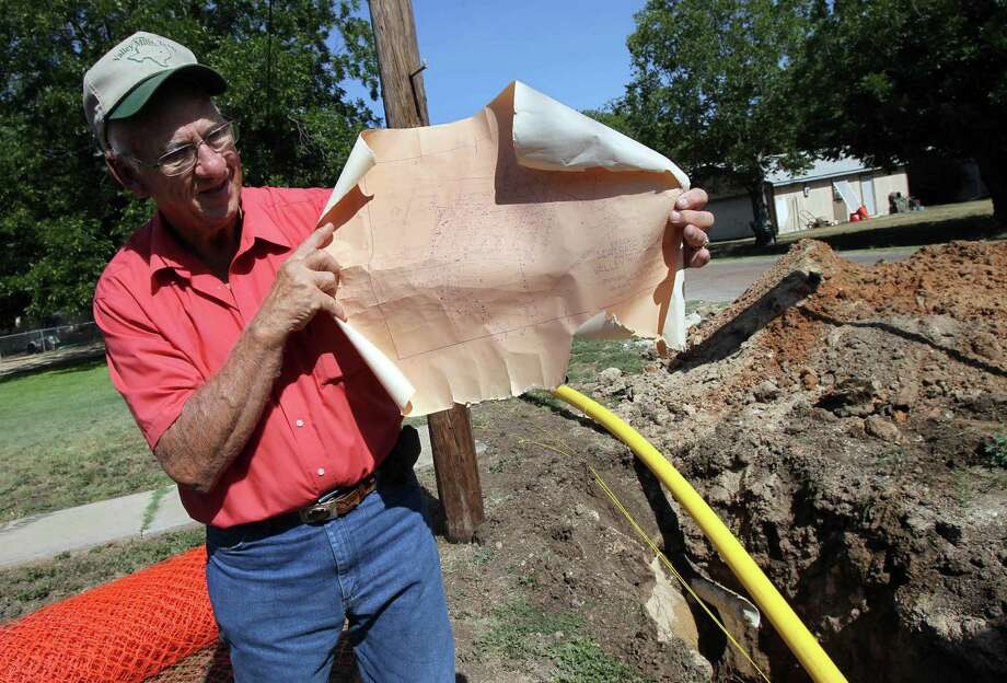 In this July 31, 2012 photo, Valley Mills city administrator Bill Lancaster holds a tattered map from 1929, which he relies on for locating water and sewer lines, in Valley Mills, Texas. Many small towns like Valley Mills don't have the money to make a commitment to quality infrastructure. (AP Photo/Waco Tribune-Herald, Duane A. Laverty) Photo: Duane A. Laverty, MBO / Waco Tribune Herald