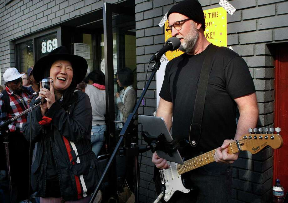 Comedian Margaret Cho (left) and Bob Mould perform at Larkin Street Services youth shelter, Lark-Inn, to raise spirits — and funds for the homeless. Photo: Liz Hafalia / The Chronicle / ONLINE_YES