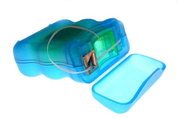 a pack of dental floss; DENTAL CARE