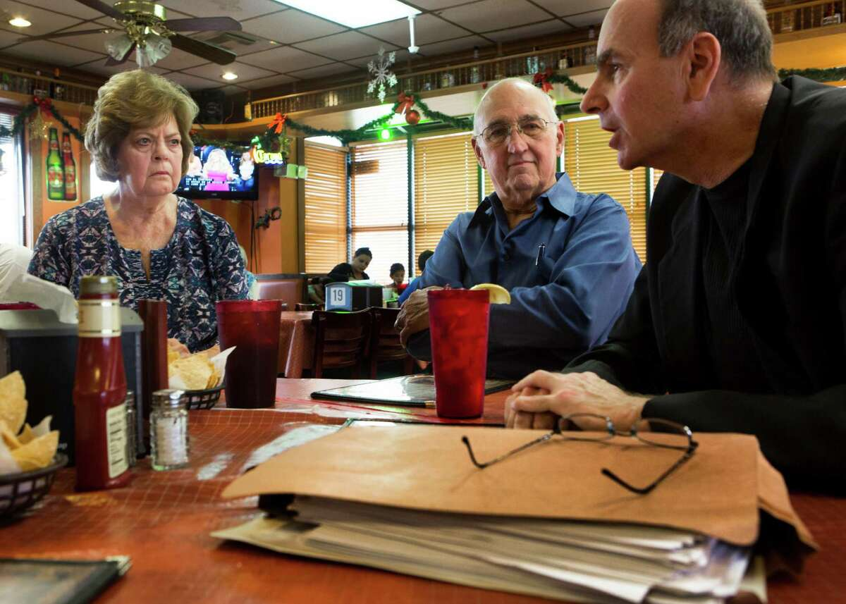 Andy Kahan, right, a victim advocate, prepares Elaine Dreymala, left, and her husband James Dreymala, center, for the parole review of David Owen Brooks. Brooks was convicted for helping Dean Corll kill at least 29 boys along with Elmer Wayne Henley. Thursday, Dec. 4, 2014, in Angleton.
