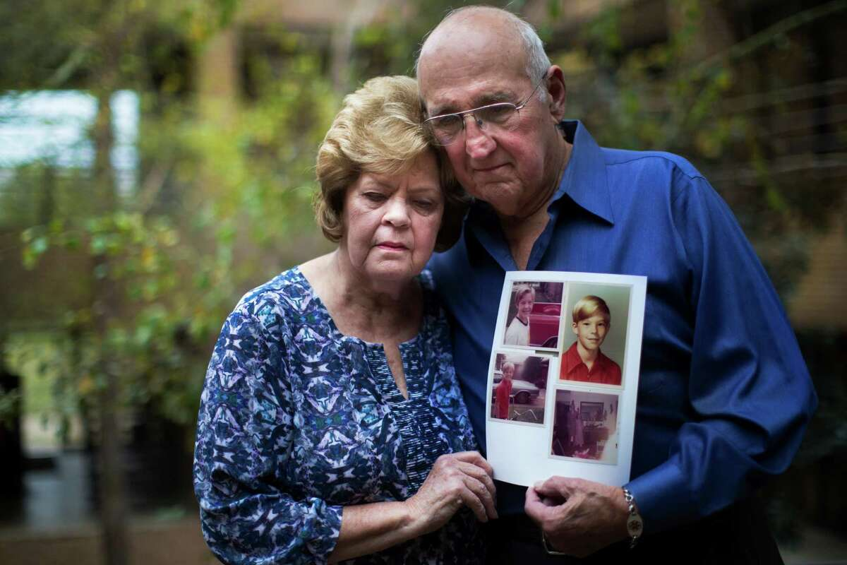 Elaine Dreymala, left, and her husband James Dreymala, hold a photograph of their son Stanton Dreymala, the last victim to die at the hands of serial killer Dean Corll and his two accomplices. Stanton Dreymala was killed at the age of 13 in Pasadena.