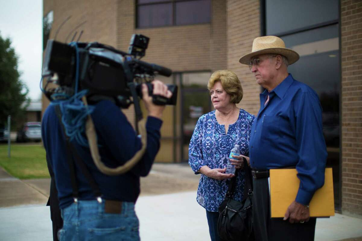 Elaine Dreymala, center, and her husband James Dreymala stop to speak to television cameras after speaking in the parole review of David Owen Brooks, one of the men responsible for the death of their son Stanton Dreymala. The parents of Stanton have had to relive the brutal 1973 death of their only son every time there's a parole review for Elmer Wayne Henley and David Owen Brooks.
