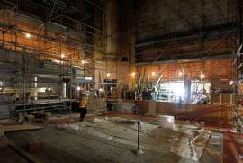 Restoration work continues inside the Herbst Theatre and the Veterans Memorial building in San Francisco on Nov. 25. The project is scheduled for completion in September.