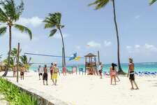 Guests play sand volleyball at Barcelo Punta Cana
