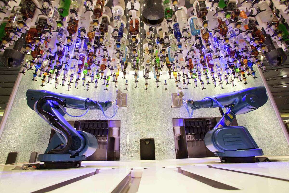 The Bionic Bar aboard Royal Caribbean's Quantum of the Seas features two robotic arms that can craft, mix and pour a variety of cocktails and drinks.