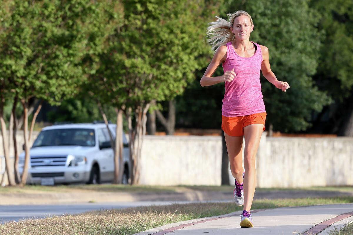 Andrea Duke runs along Schertz Parkway on Sept. 17 in preparation for the Rock 'n' Roll Philadelphia Half Marathon the following Saturday.