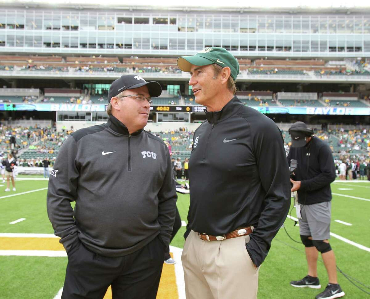 Baylor coach Art Briles, right, and TCU Gary Patterson talk before their game on Oct. 11, 2014, in Waco.