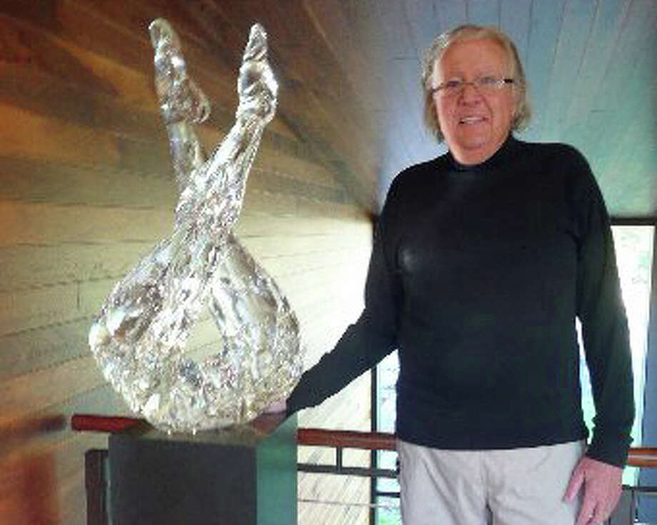 Seven Bridges Foundation founder and art collector Richard McKenzie stands next to the glass sculpture, Sentinel by Martin Blank. Photo: File Photo / Greenwich Time File Photo