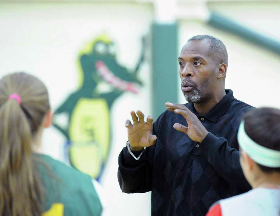 Wes Matthews speaks with his team at the start of the Greenwich Academy basketball practice at the school in Greenwich, Conn., Friday, Dec. 5, 2014. Matthews is the new head basketball coach of the Greenwich Academy varsity team. Matthews was a star basketball player at Harding High School in Bridgeport and is a former NBA player who was a member of two Los Angeles Laker championship teams. Photo: Bob Luckey / Greenwich Time