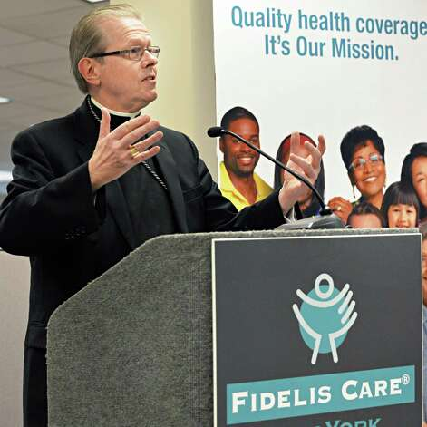 Bishop Edward Scharfenberger speaks during ceremonies opening Fidelis Care's expanded Albany regional office in a ribbon-cutting ceremony Friday Dec. 5, 2014, in Albany, NY.  (John Carl D'Annibale / Times Union) Photo: John Carl D'Annibale / 00029709A