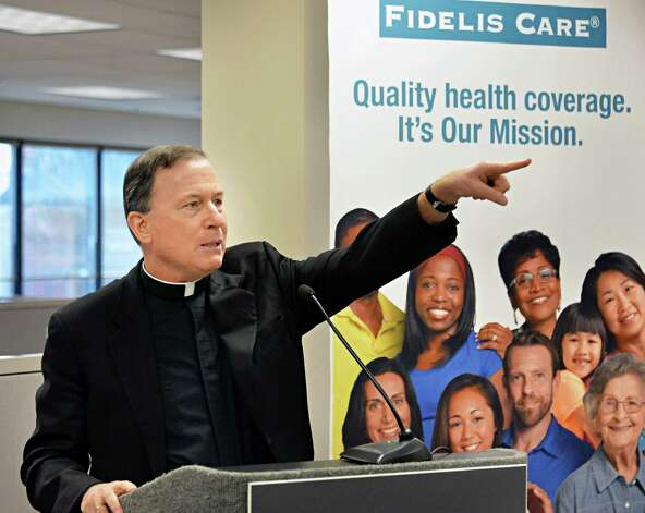 Fidelis Care president and CEO Rev. Patrick Frawley speaks during ceremonies opening Fidelis' expanded Albany regional office in a ribbon-cutting ceremony Friday Dec. 5, 2014, in Albany, NY.  (John Carl D'Annibale / Times Union) Photo: John Carl D'Annibale / 00029709A