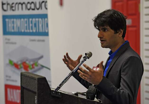 Rutvik Mehta, CEO of ThermoAura speaks at the open house for his company Friday morning Dec. 5, 2014 in Colonie, N.Y.  ThermoAura was also the recipient of another $100,000 investment by the Eastern New York Angels at the open house.  (Skip Dickstein/Times Union) Photo: SKIP DICKSTEIN / 00029761A