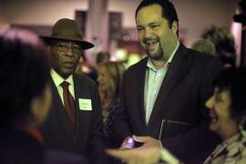 Ben Jealous (right) and the Rev. Amos Brown (left) chat with attendees at a Kapor Foundation fundraiser at Twitter in San Francisco. Once head of the national NAACP, at Kapor Foundation, Jealous is creating a pipeline to tech jobs for people of color.
