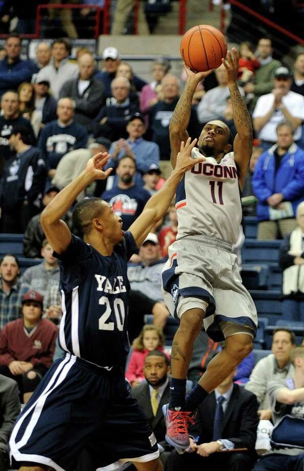 Connecticut's Ryan Boatright (11) shoots over Yale's Javier Duren (20) during the first half of an NCAA college basketball game in Storrs, Conn., on Sunday, Dec. 5, 2014. Photo: Fred Beckham, AP / Associated Press