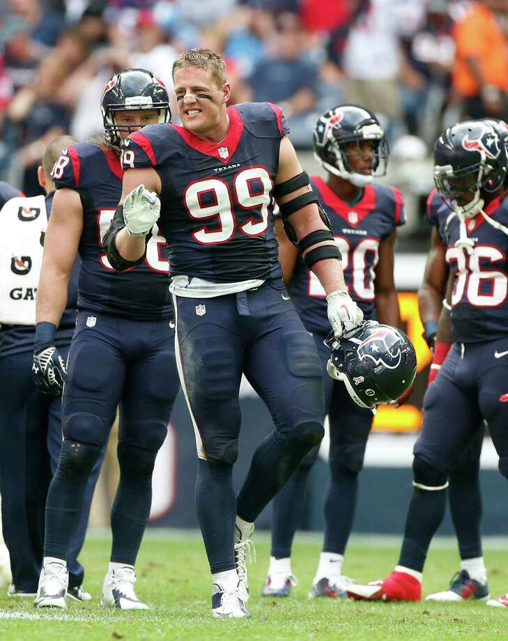 Houston Texans defensive end J.J. Watt (99) yells back to the Tennessee Titans during a time out in the second quarter at an NFL football game at NRG Stadium, Sunday, Nov. 30, 2014, in Houston.  ( Karen Warren / Houston Chronicle  ) Photo: Karen Warren, Staff / © 2014 Houston Chronicle