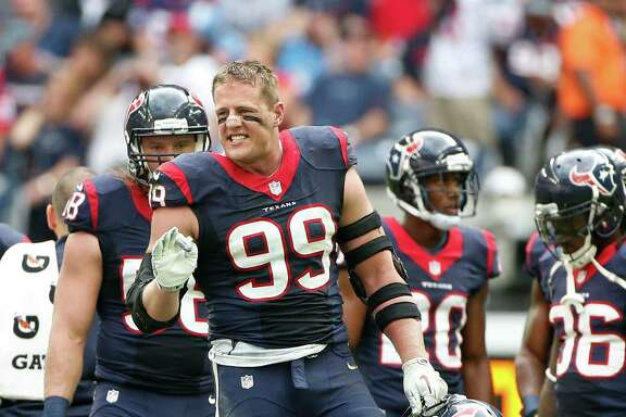 Houston Texans defensive end J.J. Watt (99) yells back to the Tennessee Titans during a time out in the second quarter at an NFL football game at NRG Stadium, Sunday, Nov. 30, 2014, in Houston.  ( Karen Warren / Houston Chronicle  )