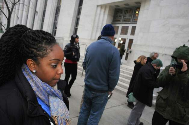 Clyanna Lightbourn of Troy talks about the judicial handling of the killings of Michael Brown and Eric Garner while in front of the James T. Foley United States Courthouse on Friday Dec. 5, 2014 in Troy, N.Y.  (Michael P. Farrell/Times Union) Photo: Michael P. Farrell / 00029765A