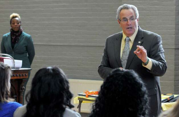 Troy Mayor Lou Rosamilia addresses the ten women graduates from Jamison-Rounds Ready for Work Program at the YWCA of the Greater Capital Region on Friday Dec. 5, 2014 in Troy, N.Y.  (Michael P. Farrell/Times Union) Photo: Michael P. Farrell / 00029752A