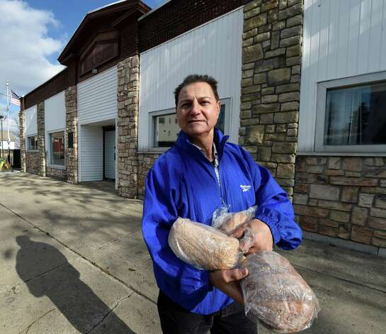 Pastor James Bookhout stands outside the new building that was purchased by The Bridge Christian Church for 10K Tuesday morning, Nov. 18, 2014, at 735 Crane Street in Schenectady, N.Y. (Skip Dickstein/Times Union) Photo: SKIP DICKSTEIN / 00029507A