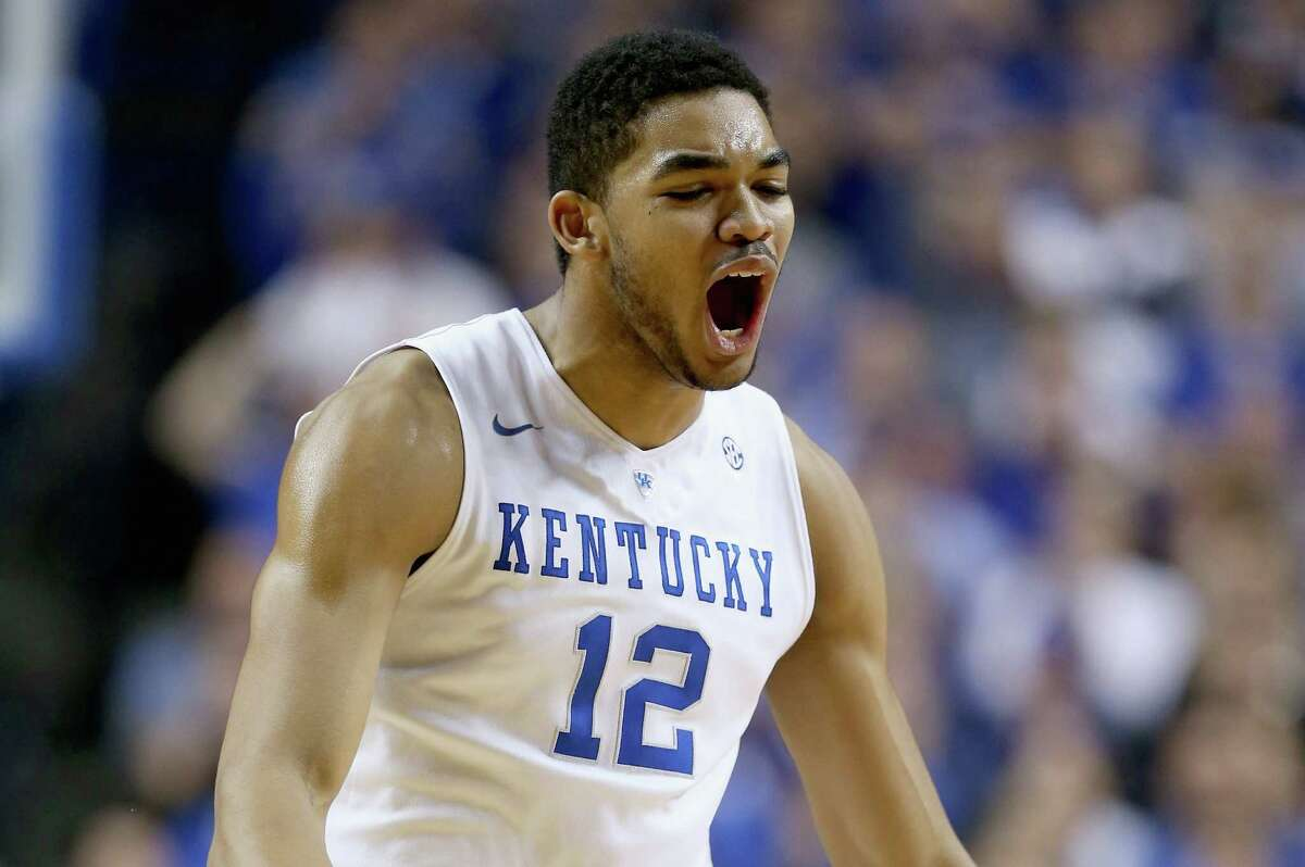 LEXINGTON, KY - DECEMBER 05: Karl-Anthony Towns #12 of the Kentucky Wildcats celebrates during the game against the Texas Longhorns at Rupp Arena on December 5, 2014 in Lexington, Kentucky.