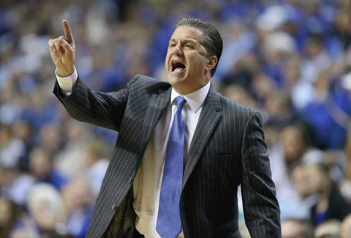 LEXINGTON, KY - DECEMBER 05: John Calipari the head coach of the Kentucky Wildcatsgives instructions to his team during the game against the Texas Longhorns at Rupp Arena on December 5, 2014 in Lexington, Kentucky.